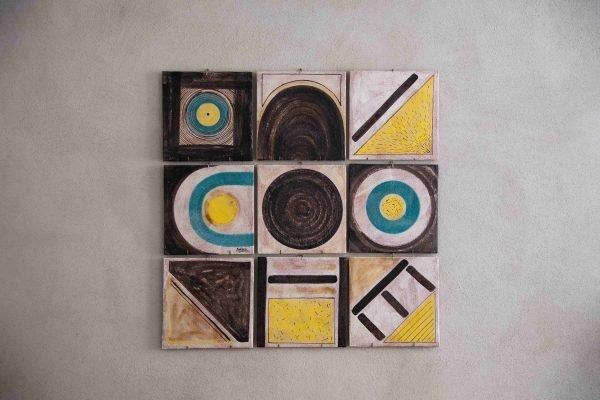 Pannello murale con piastrelle quadrate decoro segno